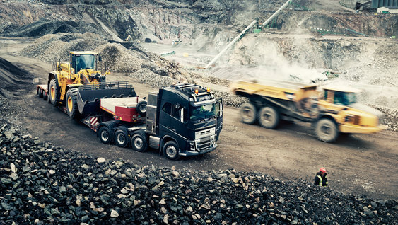 Volvo FH16 with loaded trailer in the gravel pit